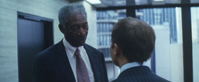 Lucius Fox meets with Coleman Reese in The Dark Knight (2008).