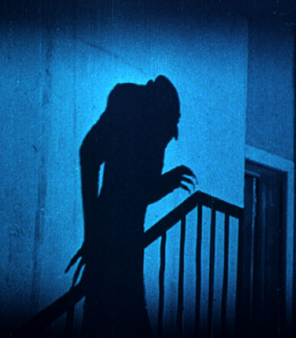 Nosferatu(1923)-Famous image of the vampire's shadow.