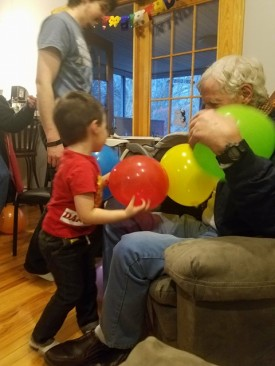 Family having a balloon battle.