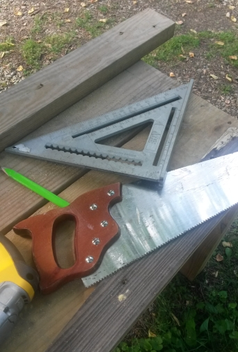 Saw and tools with boards.
